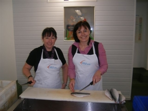 Carole-ann manager at STC, showing Anne how to fillet