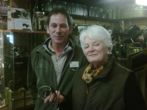 Marion having her reel fixed by the manager at Game Fishing Supplies