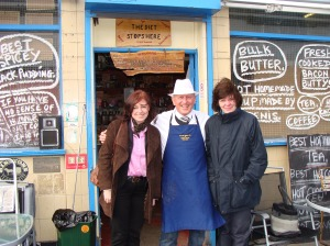 anne and sarah thanking the shop keepers who are collecting for the big fish
