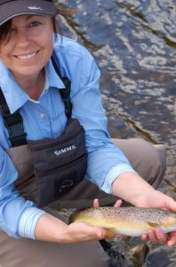 Anne Woodcock Ladies Fishing with a Brown Trout she caught on the Fly