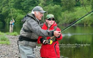 Cliff with a beginner to salmon fishing S&TA junior day